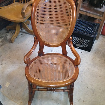 Appears to be a Rattan Rocking Chair