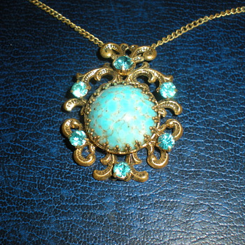 Art Nouveau pendant with chain.