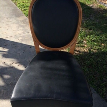 Black wooden low oval back chair