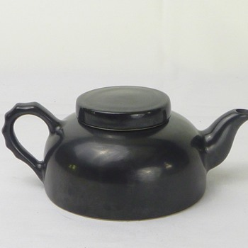 Small black ceramic teapot