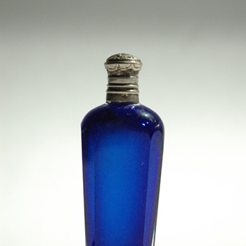 A stunning cobalt blue perfume bottle