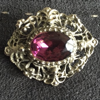 Silver and purple brooch