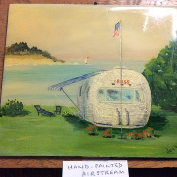 Hand painted tile of an Airstream Trailer.  Well painted, very unusual and strangely attractive.