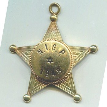 Blackinton N.I.G.P. Advertising  Badge Medal