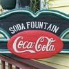 carved wooden soda fountain coca cola sign