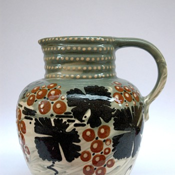 french  art nouveau pottery pitcher with vineyard pattern by LEON ELCHINGER