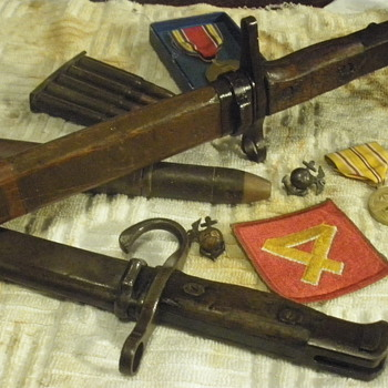 Two Japanese WWII era bayonets. Tokyo and Toyoda maker marks. 