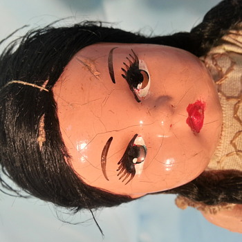 very old paper mache or composition doll mexico ?