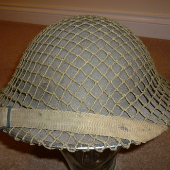 British WW11 helmet with cammo net. - Military and Wartime