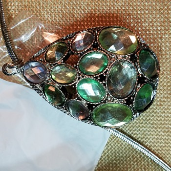 Silver necklace with green tear drop pendant