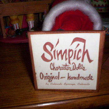 Can someone please tell me about my Simich Santa? His age and name