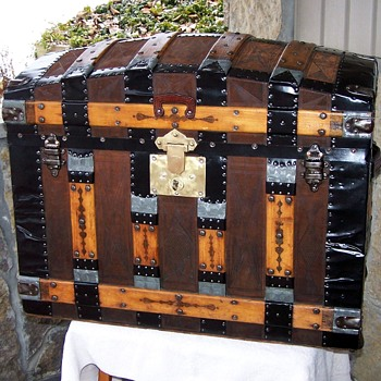 ANTIQUE LEATHER COVERED TRUNK