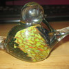 Glass paperweight of conjoined ducks.