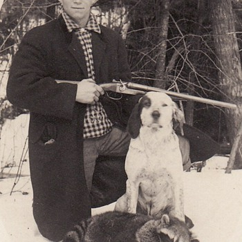Photograph of Hunter with Shotgun, his dog and dead racoon