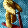 Antique Fewo Teddy Bear on a Scooter Toy