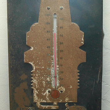 How old is the metal AC spark plug thermometer sign.