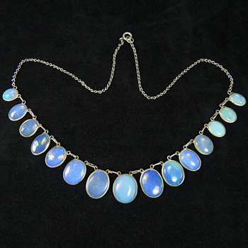 A Necklace of Blue Jelly Opal, circa 1910