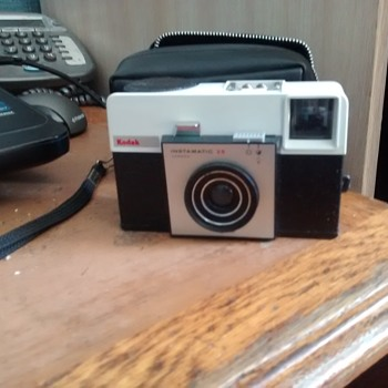 Kodak Instamatic 25 with case, one of the most basic cameras of the 1960s and the easiest to use.