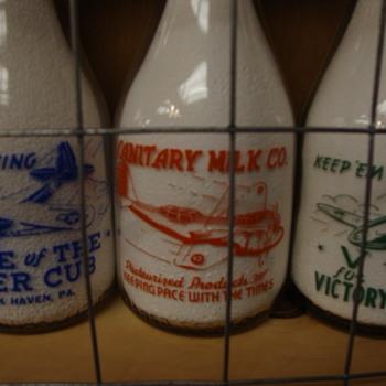 War Slogan Milk Bottles With Airplanes....