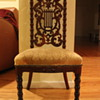 Small antique chair with carved angel's harp