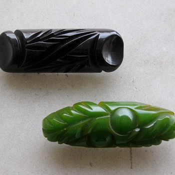 Carved black and green bakelite pins