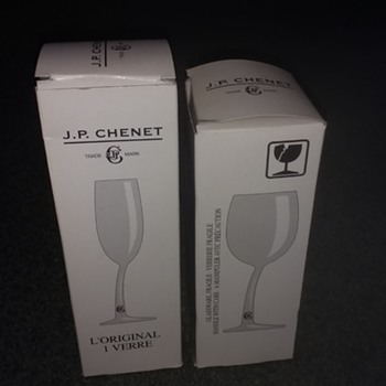 Modern Glass but very different. J P Chenet wonky stem wine glasses, not a pair but little and large.