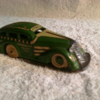 old tin lithograph cars from...?  I know the matchbox cars but I could use an opinion here!