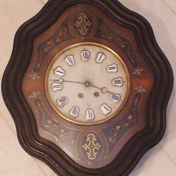 Antique French Oeil de Boeuf Ebonized Wall Clock