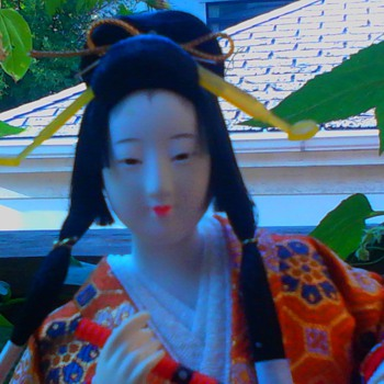 Flute player with bonsai pine branch detail on sleeve  (continued) - Dolls