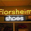 Here's a couple old neon signs I own. Florsheim Shoes and Plastering sign