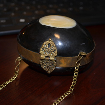 Egg shaped brass and possibly Ivory clutch