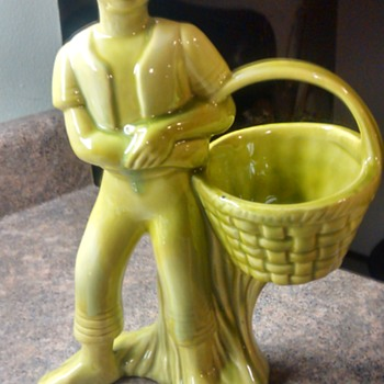 Green mixed glass boy with basket in vase?