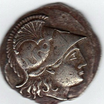 An anciant greek coin perhaps?