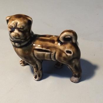 Pottery pug dog
