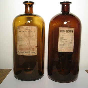 A pair of Cough Medicine Bottles