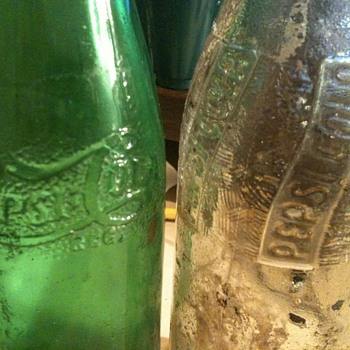 old green pepsi bottle and clear pepsi bottle
