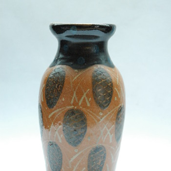 art nouveau pottery vase with pinecone pattern by LEON ELCHINGER circa 1910