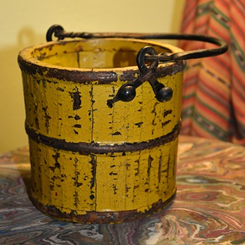 Very old berry bucket in mustard paint with a forged iron handle
