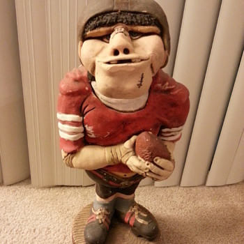 1973 statue of a comical football player - not sure of the artist's signature - Football