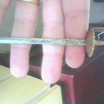 i think this is a letter opener its well over 15 years old can anyone help identify it - Kitchen