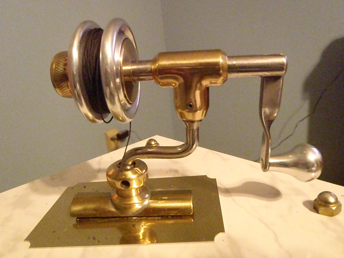 Antique bailless spinning reel prototype i think for Vintage fishing reels