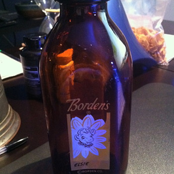 Borden's Elsie brown glass milk bottles