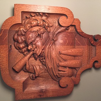 Carving of man drinking beer - Furniture