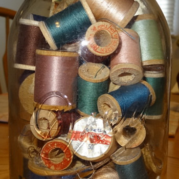 Yard sale find Old Drey Jar with Wood Thread Spools - Bottles