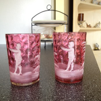 Pink glassware with etchings of young child