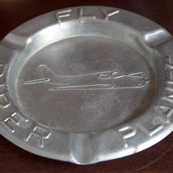 Two views of a Piper Airplane Ashtray - Advertising