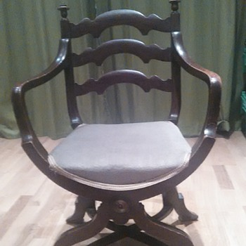Completely confused by this chair. Age? & origin? suggestions please.