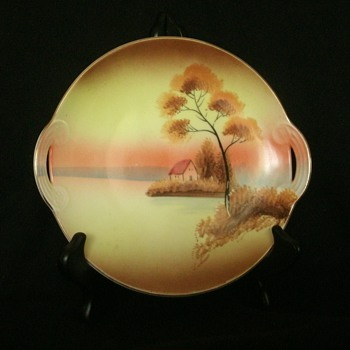 "Meito China 8"" handled plate with hand painted cottage on lake scene"