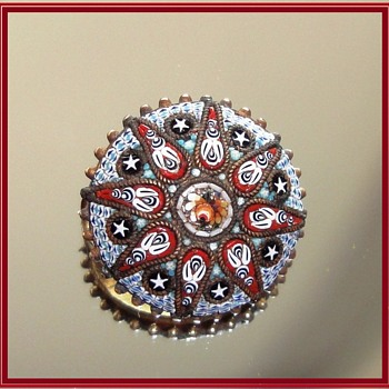 Round Micro Mosaic brooch depicting stars and flowers.