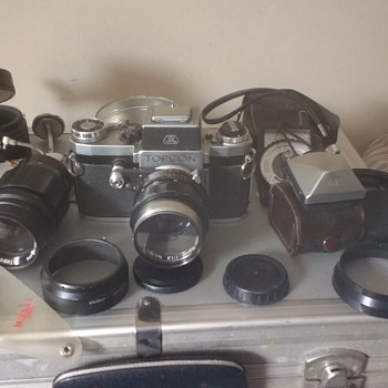 A TopCon R film camera with lenses, an Extra Prisim, Filters, case, tube extensions and various bits!